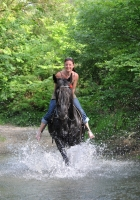 "Fun in the river on horseback on <a href=""http://www.adventureride.eu/en/select-dates/through_the_rivers_of_gauja_national_park/"">horseback riding vacation</a> in Gauja national park"